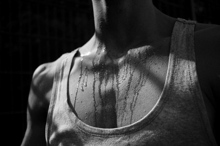 This shows a person drenched in sweat