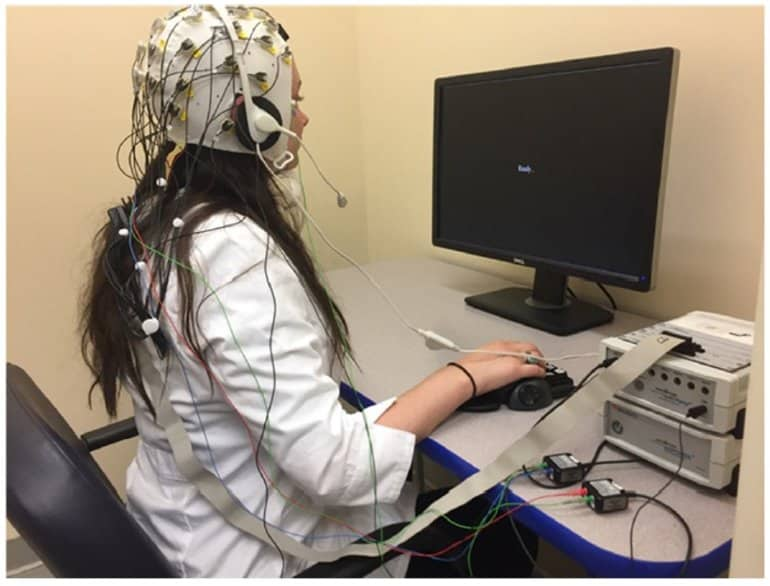 This shows the researcher in an EEG cap taking a computerized memory test