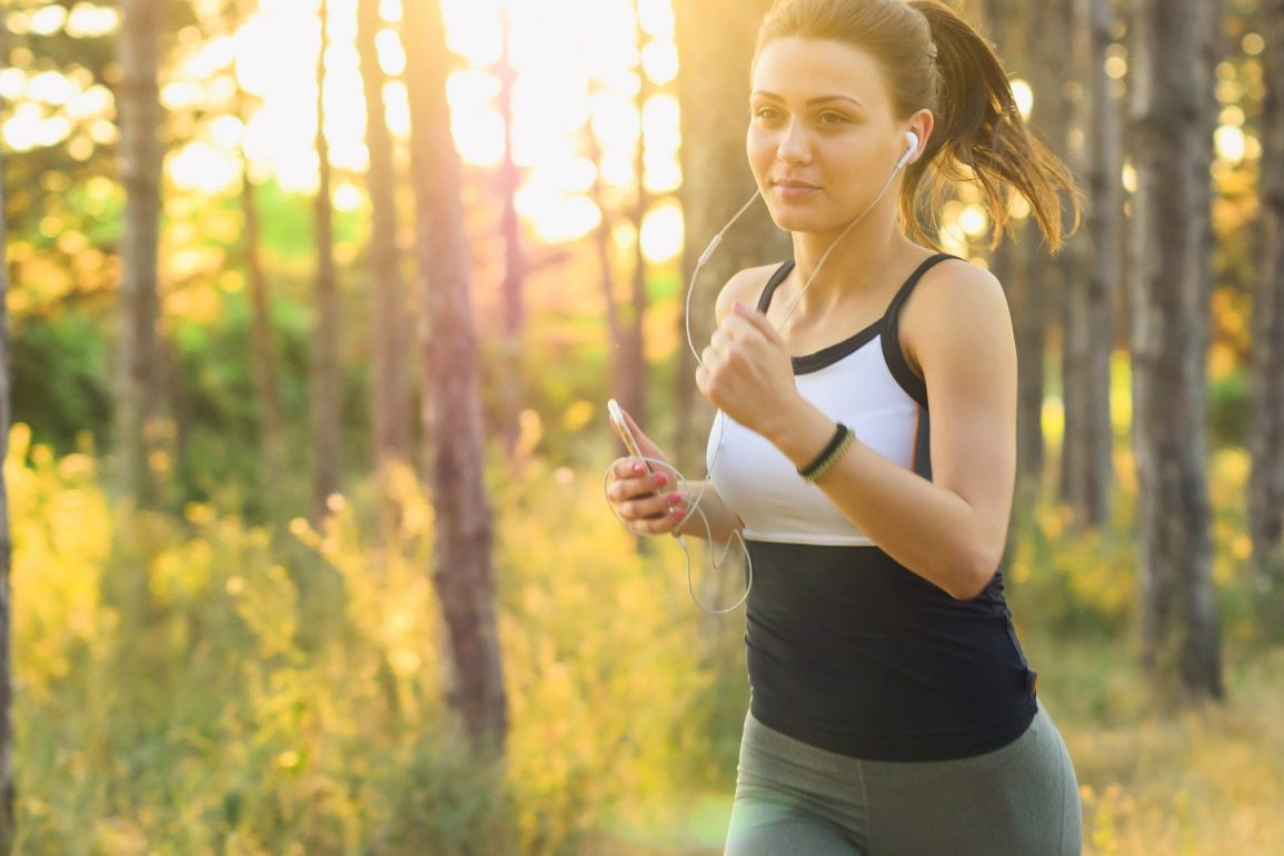 This shows a woman running with headphones on