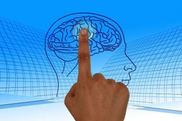 This shows a finger touching an image of a brain