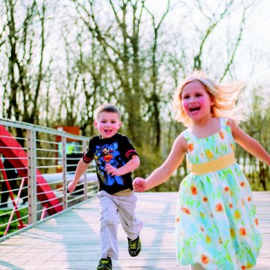 This shows a little boy and girl running and having fun