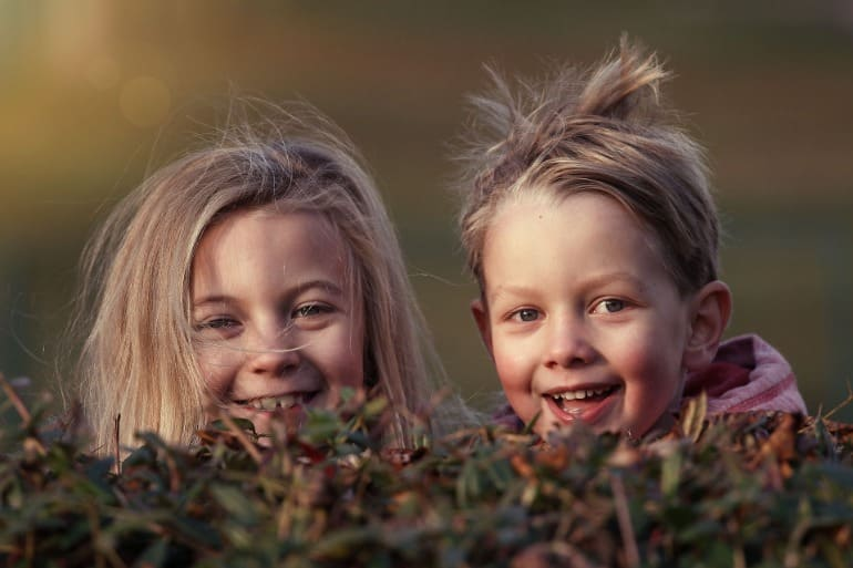 This shows a sweet, playful looking little boy and girl