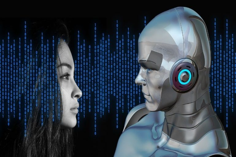 This shows a woman and a robot looking at eachother