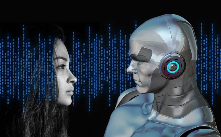 This shows a woman looking at a robot