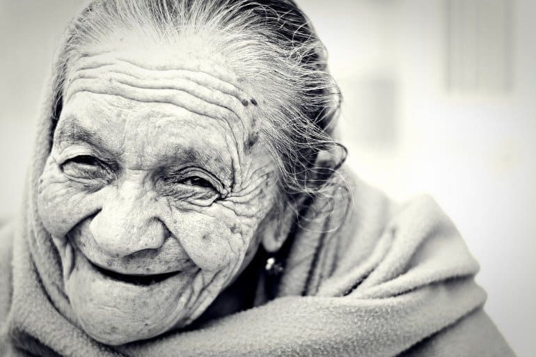 This shows a smiling older lady