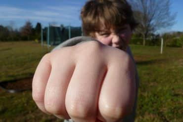 This shows a kid making a fist