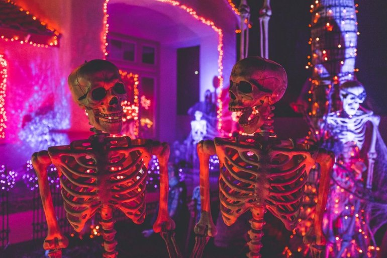 This shows models of halloween skeletons lit up with neon lights