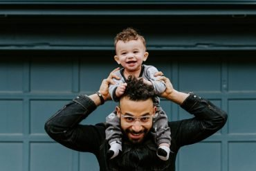 This shows a happy dad and happy toddler