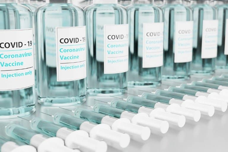 This shows vaccine vials with COVID written on them