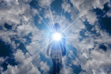 This shows a man in clouds, surrounded by bright light