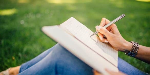 This shows a woman writing in a journal