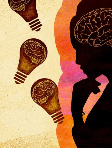 This shows the outline of a woman and a brain surrounded by lightbulbs