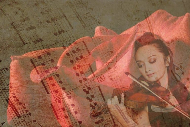 This shows sheet music and a girl playing a violin