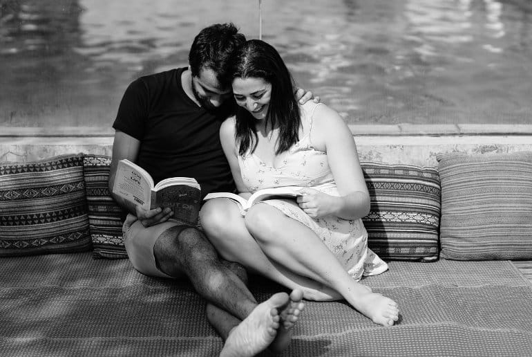 This shows a couple reading to eachother