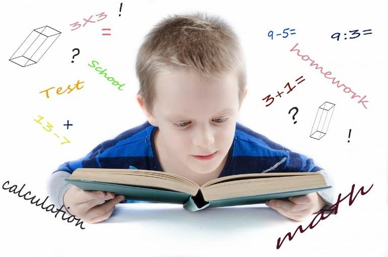 This shows a little boy reading a book, surrounded by math symbols, sums and words associated with math