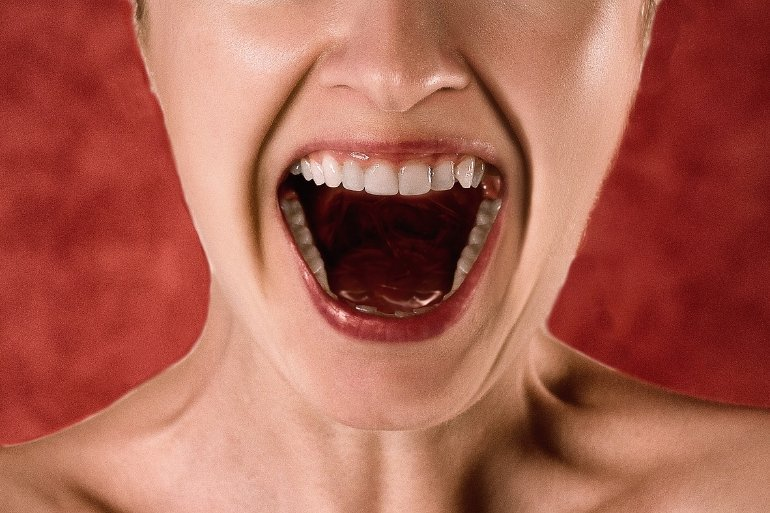 This shows a woman screaming