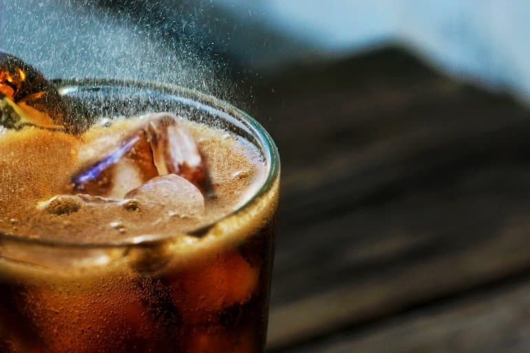 This shows a glass of soda