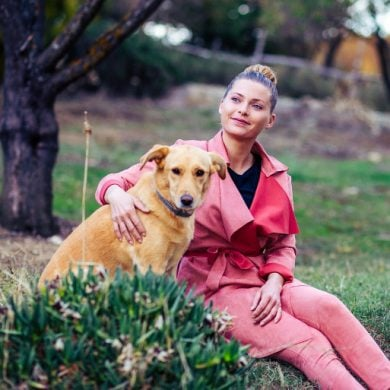 This shows a woman and her dog