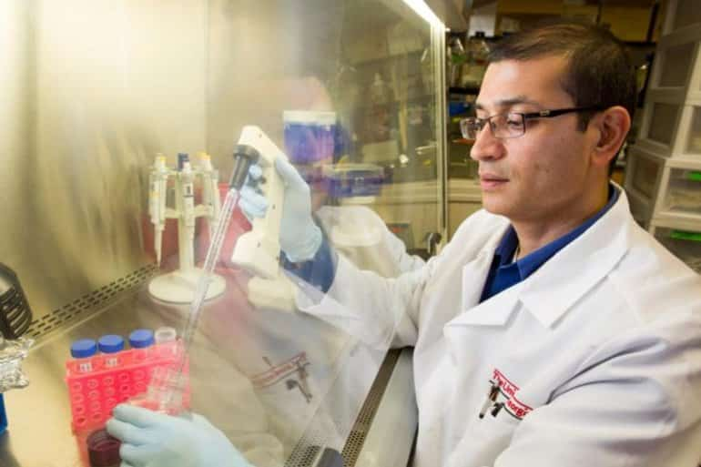 This shows the researcher in his lab