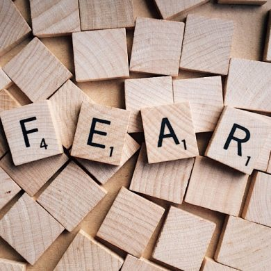 This shows the word fear written in scrabble tiles
