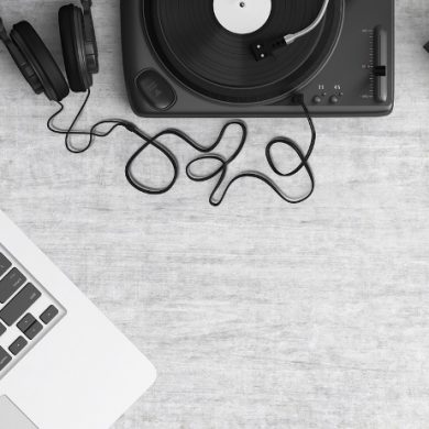 This shows a record player, record and laptop