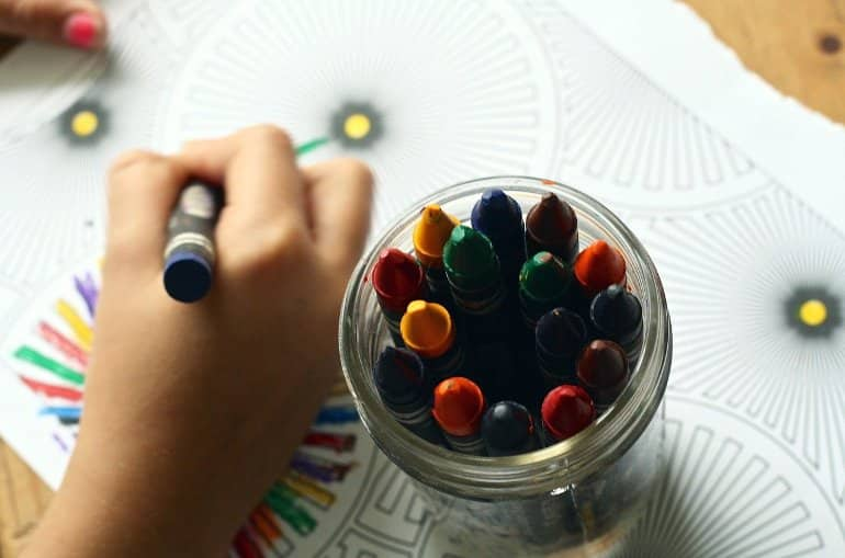 This shows a child coloring in