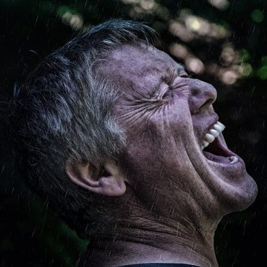 This shows a man screaming in the rain