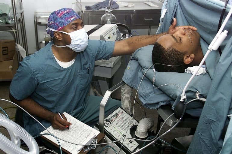 This shows an anesthesiologist taking care of a patient while under anesthetic