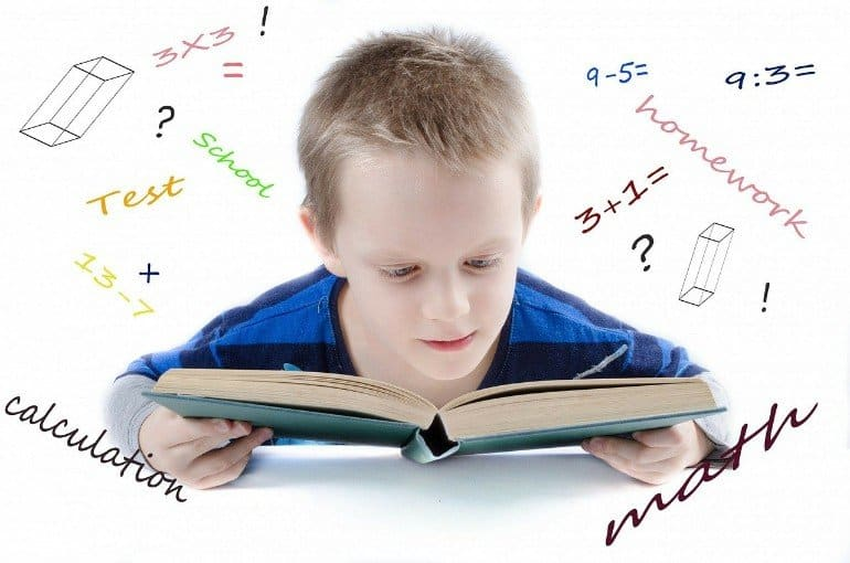 This shows a young boy reading a math textbook