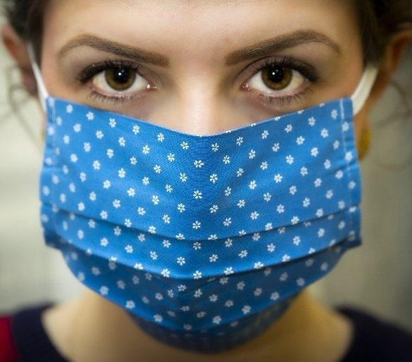 This shows a woman wearing a face mask