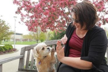 This shows the researcher and her dog