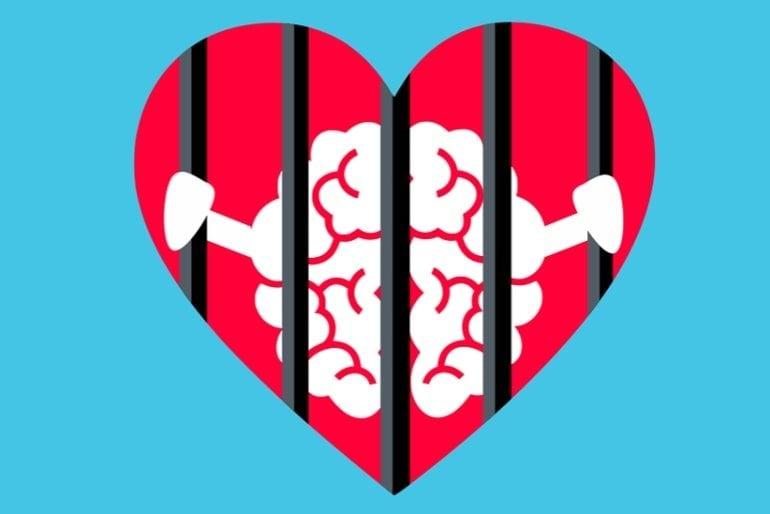 This shows a brain behind bars in a heart shape