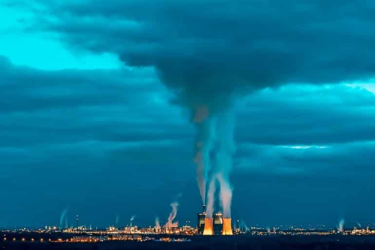 This shows cooling towers and smoke
