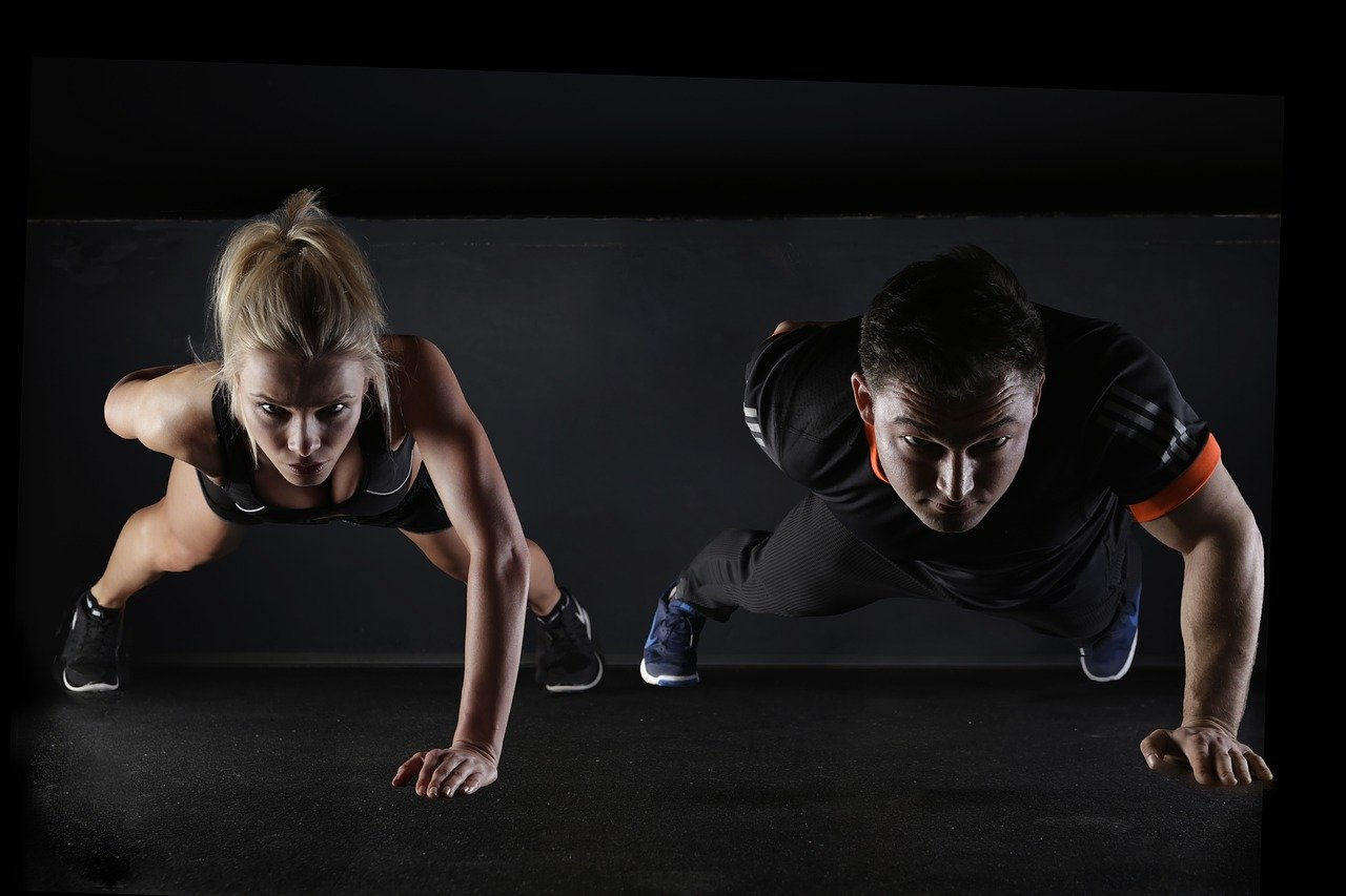 This shows a man and woman doing push-ups