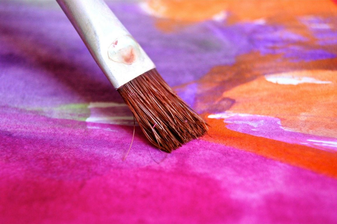 This shows a paint brush adding a bright pink to a painting