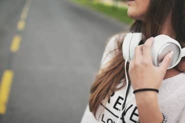 This shows a teenage girl with headphones on
