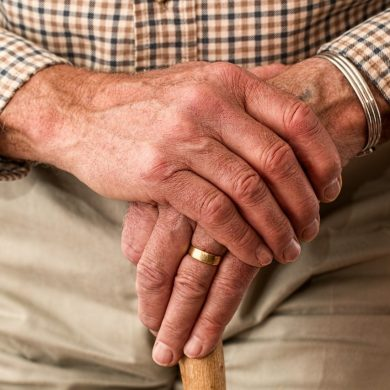 This shows an older man's hands