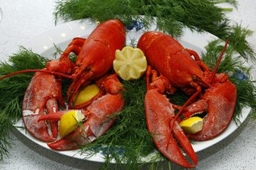 This shows two lobsters on a plate