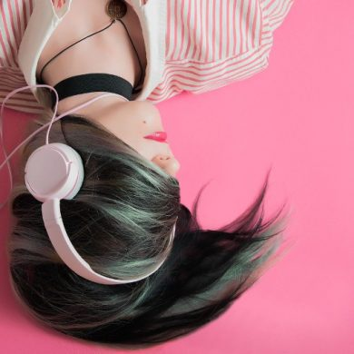 This shows a woman listening to music on headphones