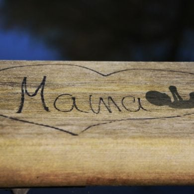 This shows a heart with the word mama and a baby drawn inside
