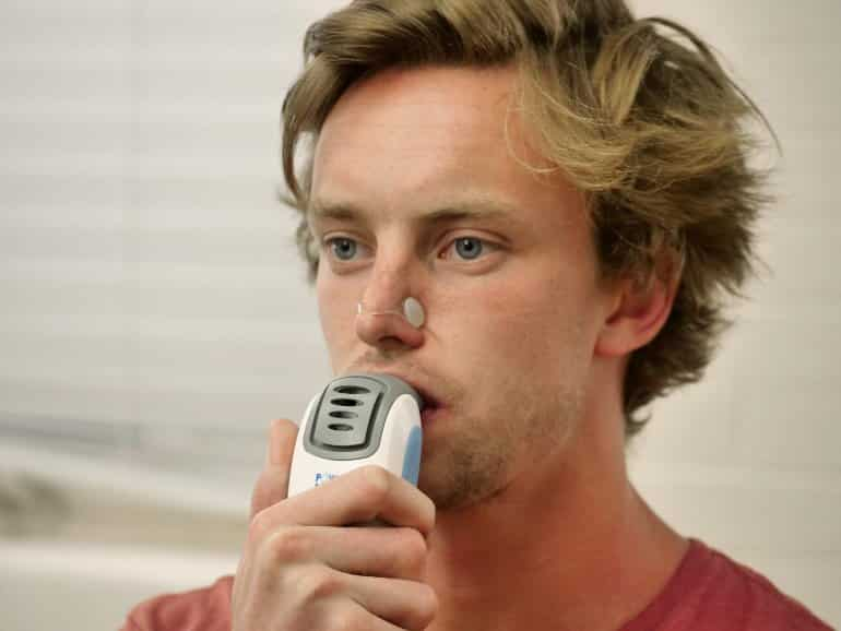 This shows one of the researchers demonstrating the power breathe device
