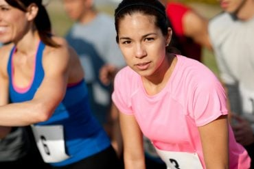 This shows a woman about to run a race