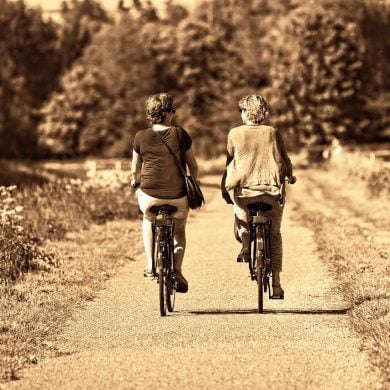 This shows two women taking a bike ride