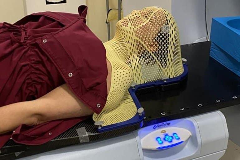 This shows a woman having a brain scan