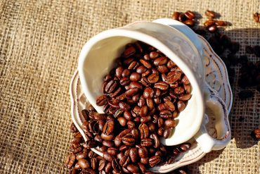 This shows a cup full of coffee beans