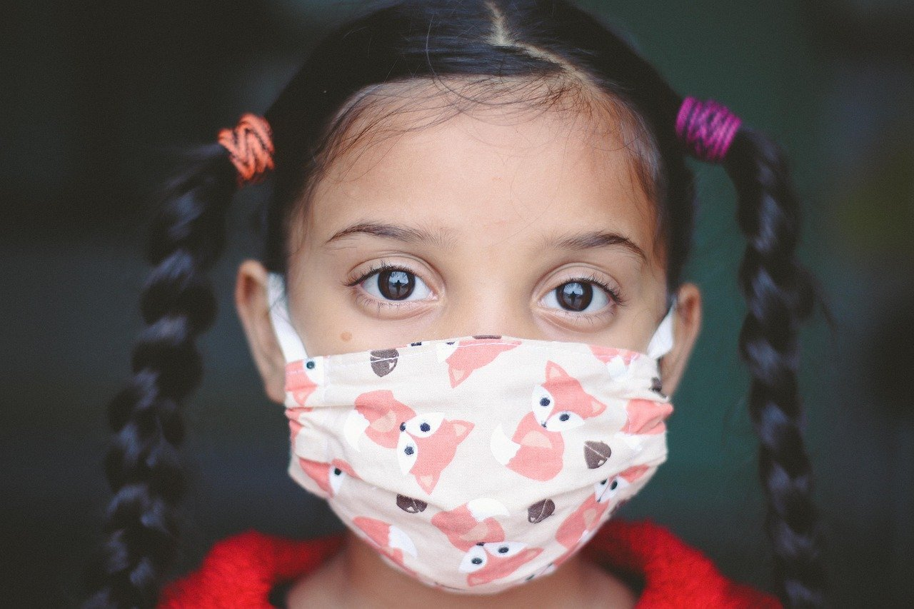This shows a little girl in a facemask