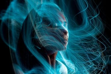 This shows a woman wrapped in blue, fuzzy lines