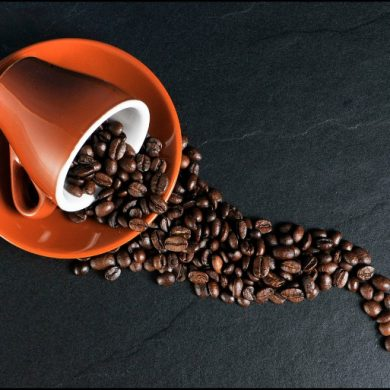 This shows a cup and coffee beans