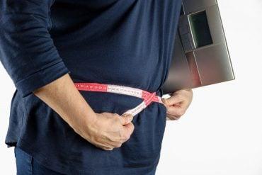 This shows a man measuring his waist