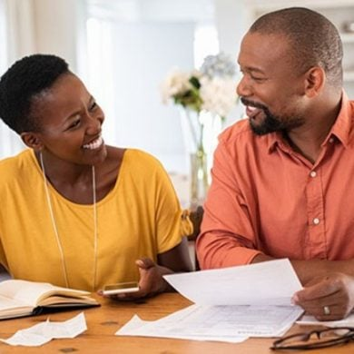 This shows a happy couple going over paperwork